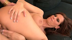 After sucking the tasty cock of this nerd, the slutty brunette MILF takes it deep in her pussy