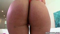 Curvacious blonde pornstar Bridgette B. bares her tanned tits and ass