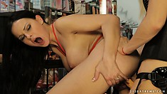 Armed with a big strap-on, lesbian Mistress makes her girl toy yell