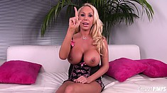 Mary Carey rubs a dildo in between her stunning and huge titties
