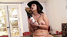 Driving a bottle in and out of her snatch, the stacked babe enjoys pure delight