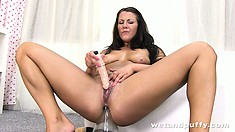 She sticks her toy up her ass and uses a vibrating toy on her clit
