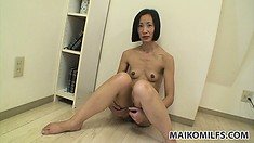 The skinny Asian lady shows off her tiny tits, hot ass and her sweet hairy peach