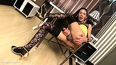 Horny shemale with long black hair and slim legs drills her ass with a big dildo