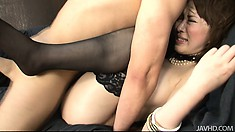 Sayaka Tsuzi opens her stockinged legs wide to let his cock inside
