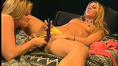 On the bed, two wonderful blondes please each other's fiery peaches with dildos