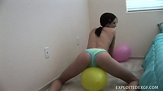 She grinds her clit against the balloon making her pussy wet