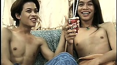 Skinny Asian boys exchange oral pleasures before engaging in hot anal action