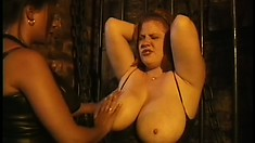 Chubby redhead gets her cowtits tortured by her sadistic mistress