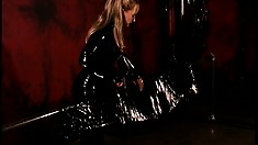 Latex mistress has her slave wrapped up in a latex sheet for punishment
