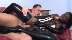 Kinky black babe in latex Lady Armani takes a big white rod up her ass