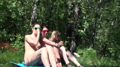 Three sexy babes share passionate kisses and please each other outside