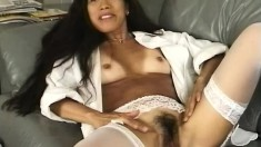 Lovely tanned Kayako uses her fingers to make her soft pussy all wet