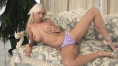 Smoking hot blonde with amazing legs rocks some sexy purple undies