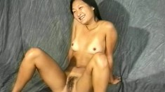 Suk puts on a smile while posing and showing her twat in a shoot