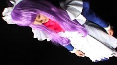 Japanese chick in costume and purple hair chews on his wanker