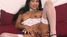 Bodacious and exotic Tina puts on her white lingerie and masturbates