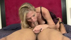 Lustful blonde milf engages in hot sex action with a hung black stud