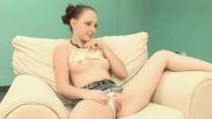 Petite brunette gets wet while taking her clothes off for the camera