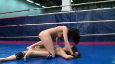 Horny lesbians Connie and Karen fight in a ring and get naughty