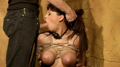 Sexy brunette gets tied up and has her mouth stuffed with a dick