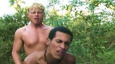 Sexy blonde twink enjoys anal sex with a cute Latino in the outdoors