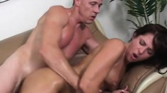 Slender brunette oils up her booty and wildly fucks a throbbing stick