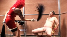 Kinky redheaded woman loves to tease by flogging this horny guy