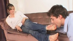 Submissive Young Guy Lets This Hot Blonde Step On His Face With Her Sexy Feet