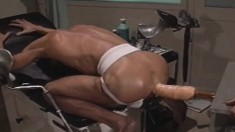 Delightful stud takes a huge dildo in his ass in the doctor's office