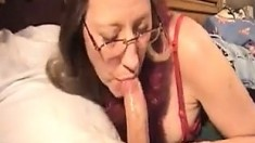 Big cock brunette MILF sucks a big cock POV