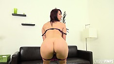Nikki does a hot striptease and shows her pouty, bald pussy lips
