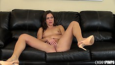 Brunette broad in high heels rubs her clit down on all fours