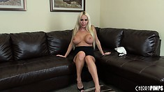 Busty Mary Carey is on the couch and does a sexy striptease show