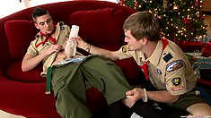 Scout leaders share their new Christmas toys with each other