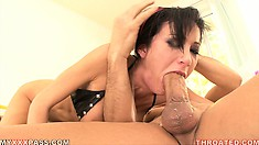 She lies on top of him and does her best to give his big rod deep throat