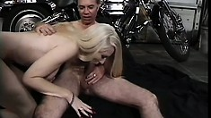 Attractive blonde with big tits has a horny biker pounding her twat like she desires