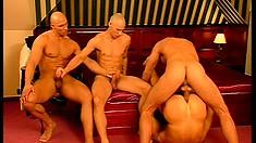 Three horny bald headed guys fuck a hot boy's anal hole like he deserves