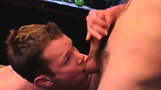Two smoking hot guys give each other a nice stroking on the couch