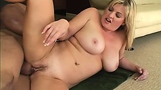 Stacked blonde bends over inviting the black stud to fuck her pussy from behind