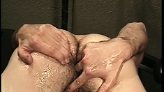 Hairy dude teases and strokes on his wang in a mechanic's shop