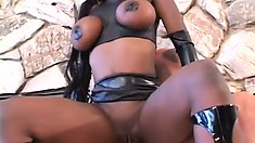 Big tit black girl takes on two white guys outside and moves in for a DP