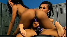 Ebony lesbians with tats have crazy hot sex in the locker room