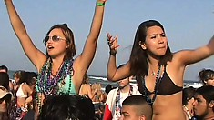 Smoking hot Latinas at a wild beach party show off their knockers