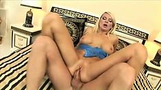 Curvy blonde MILF Winnie sits her ass down on an extra long boner