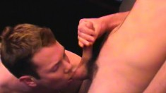 Rick and friend sit on the couch jerking their meat and licking a ball sack
