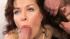 Older redhead lady gets her holes torn apart by two young studs