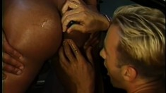 Horny blonde stud fucks the sexy black mechanic's ass from behind