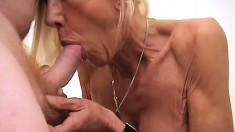 Lustful blonde granny in black lingerie gets pounded deep on the bed