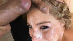 Stacked blonde slut has five guys releasing their juices on her face